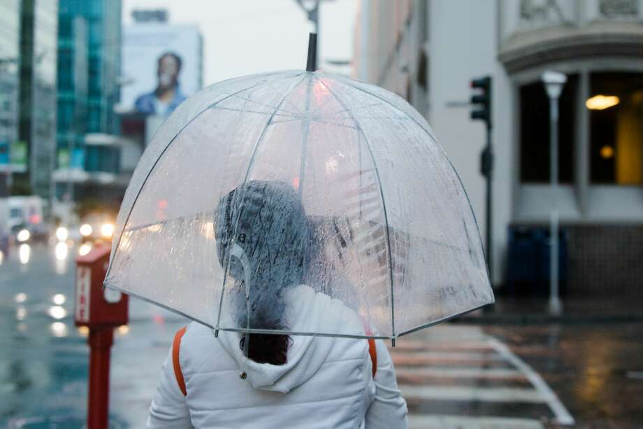 Umbrellas were used for the first time in months on Monday. The first rainfall of the season caused slick conditions during the morning commute in San Francisco on Sept. 16, 2019. Photo: Douglas Zimmerman / SFGate