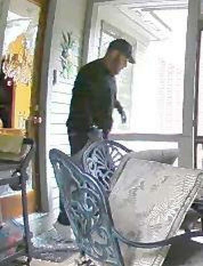 Milford Police have released photos of a man they say is a suspect in a Sept. 12 residential burglary. Photo: Milford Police Department / Milford Mirror Contributed
