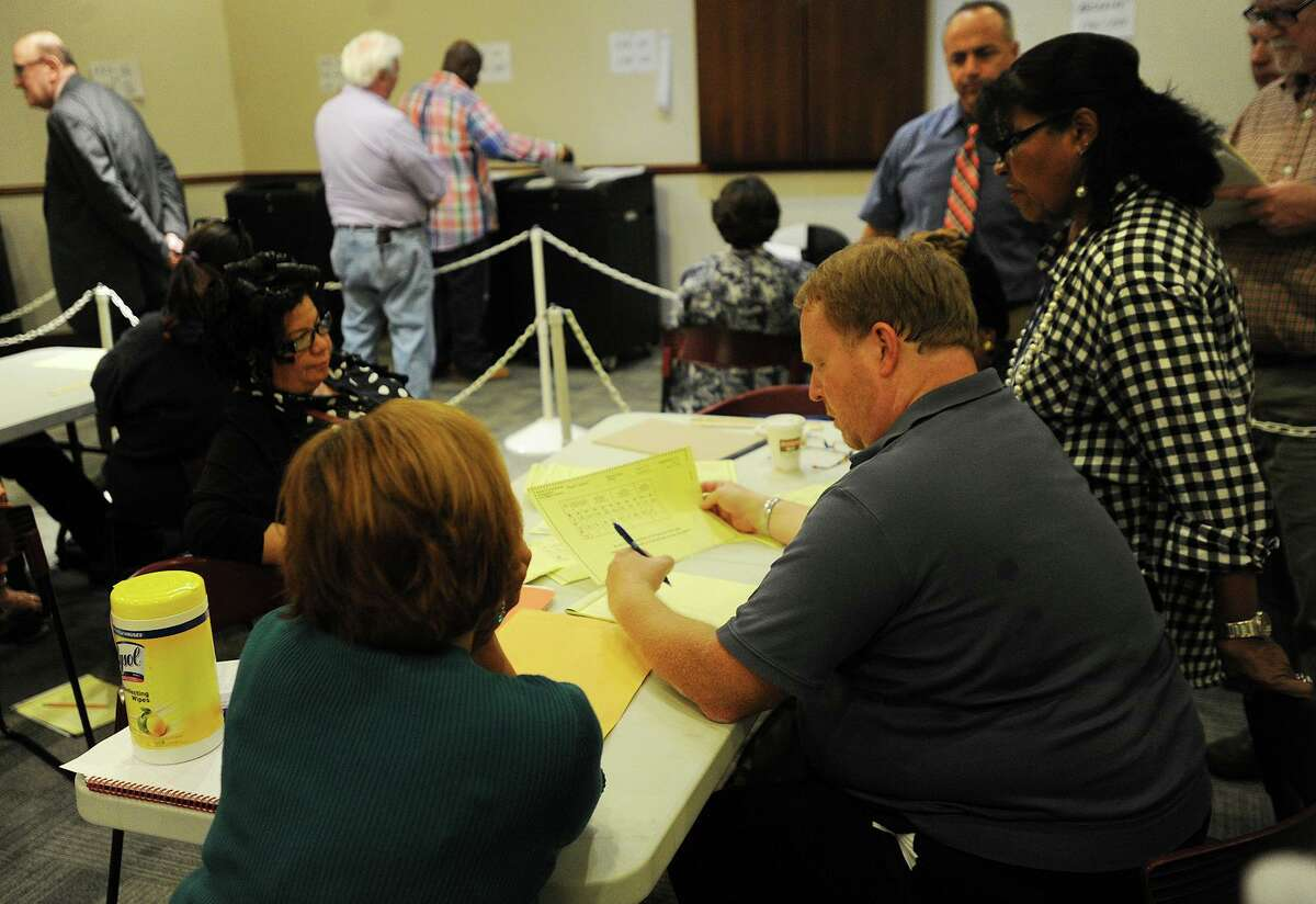 Absentee ballot head moderator Tom Errichetti looks over absentee ballots during a recount at the Margaret Morton Government Center of primary results in Bridgeport on Sept. 23, 2015.