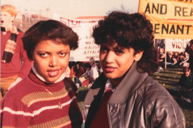 As a Howard freshman, Harris and classmate Gwen Whitfield attend a protest demanding an end to apartheid and calling for divestment from South Africa.