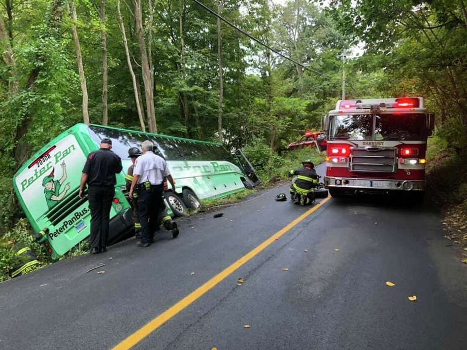 West Redding Road in Danbury is closed after a large Peter Pan coach bus went off the road on Monday, Sept. 16, 2019. Danbury Hospital EMS evaluated the driver who was not injured. No passengers were on board. Photo: Danbury Fire Department Photo