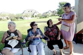 "Cathy Davis talks with friends during a block party celebrating her winning the title of ""Great Neighbor"" in the Nextdoor app's national ""Best Neighbor"" contest. Photo taken Friday, September 14, 2019 Kim Brent/The Enterprise"