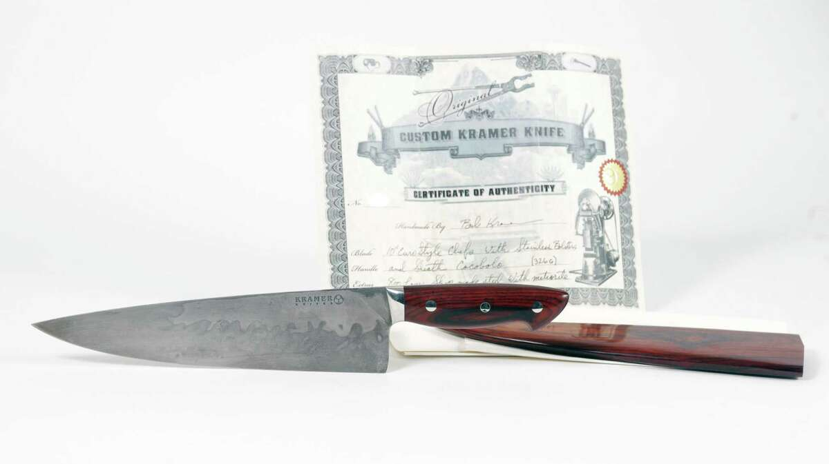 A custom-designed knife made by master bladesmith Bob Kramer will be among the items from the late Anthony Bourdain's estate exhibited in New Braunfels and sold in an online auction.