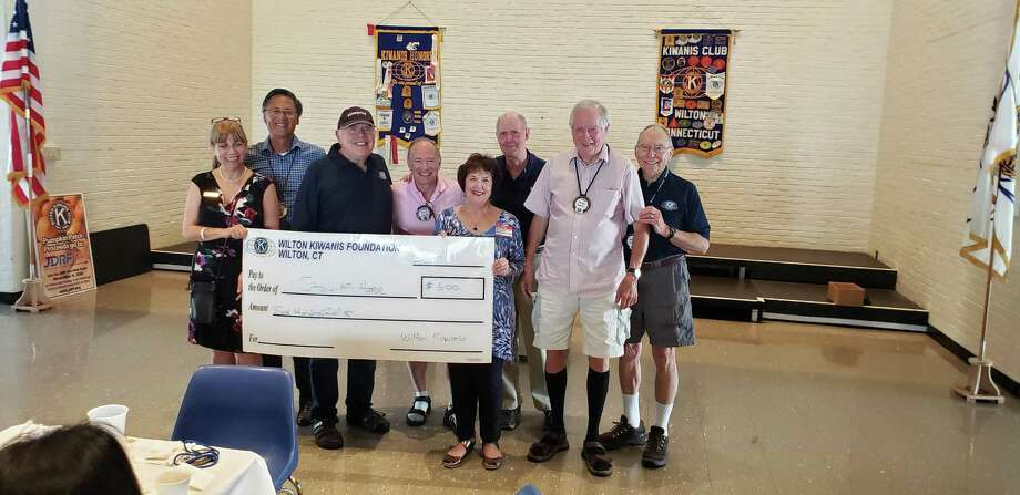 At its meeting on Sept. 11, the Wilton Kiwanis Club made a donation to Stay at Home in Wilton to be used for a scholarship to financially assist people who would like to join the organization. From left are MaryAnne Franco, Stay at Home president Sally Kirmser, Larry Mauer, Gordon Nugent and Dave Hapke. Photo: Contributed Photo / Wilton Kiwanis Club / Wilton Bulletin