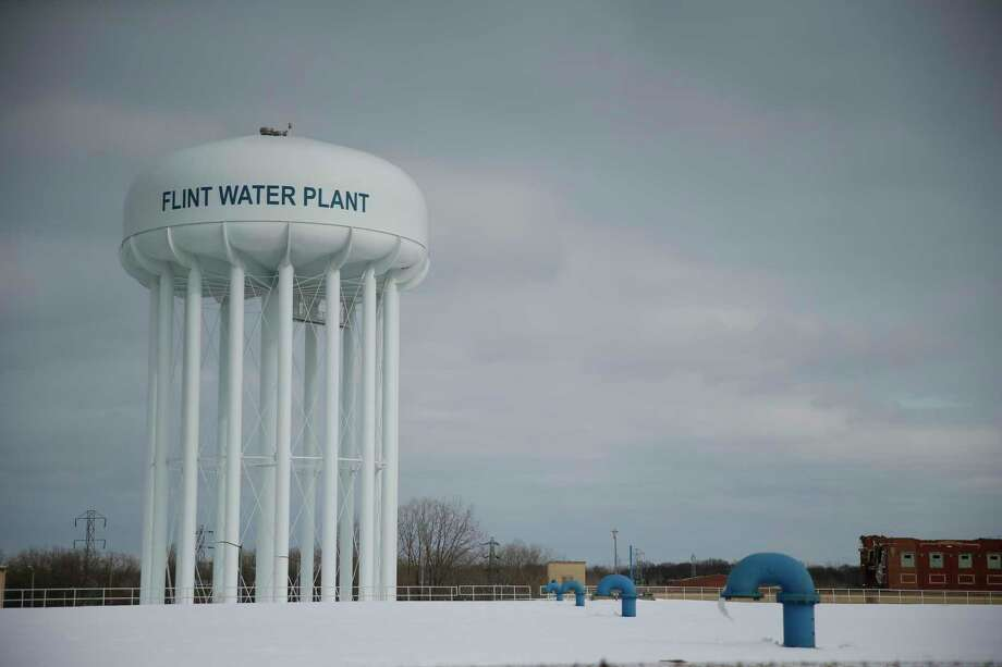 It's less costly to not pollute water in the first place than to try to clean it up later. Right, Flint, Mich.? Photo: Associated Press File Photo / AP