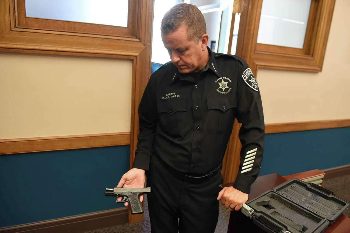 """Albany County Sheriff Craig Apple holds """"ghost gun"""" which he purchased online using Bitcoin on Monday, Sept.16, 2019, at his offices in Albany, N.Y. A loophole in federal and state gun control laws makes purchase of illegal firearms alarmingly easy. These so called ?'ghost guns?"""" are partially finished firearms that are assembled at home. They have no serial numbers. (Will Waldron/Times Union)"""
