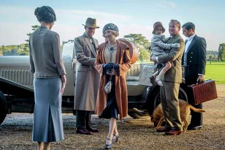 """This image released by Focus features shows Elizabeth McGovern, from left, Harry Hadden-Paton, Laura Carmichael, Hugh Bonneville and Michael Fox, right, in a scene from """"Downton Abbey."""" The highly-anticipated film continuation of the """"Masterpiece"""" series that wowed audiences for six seasons, will be released Sept. 13, 2019, in the United Kingdom and on Sept. 20 in the United States. (Jaap Buitendijk/Focus Features via AP)"""