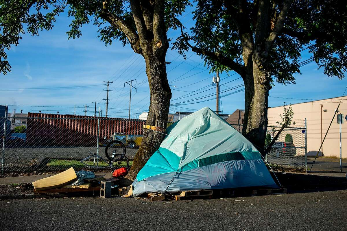 Tents on the streets of Portland, Ore., Sept. 11, 2019. Portland has spent three years sending hundreds of its homeless residents around the country to destinations where family or friends might help get them back on their feet. But city officials found that of those who could be reached three months later, nearly half had lost their promised housing. (Amanda Lucier/The New York Times)
