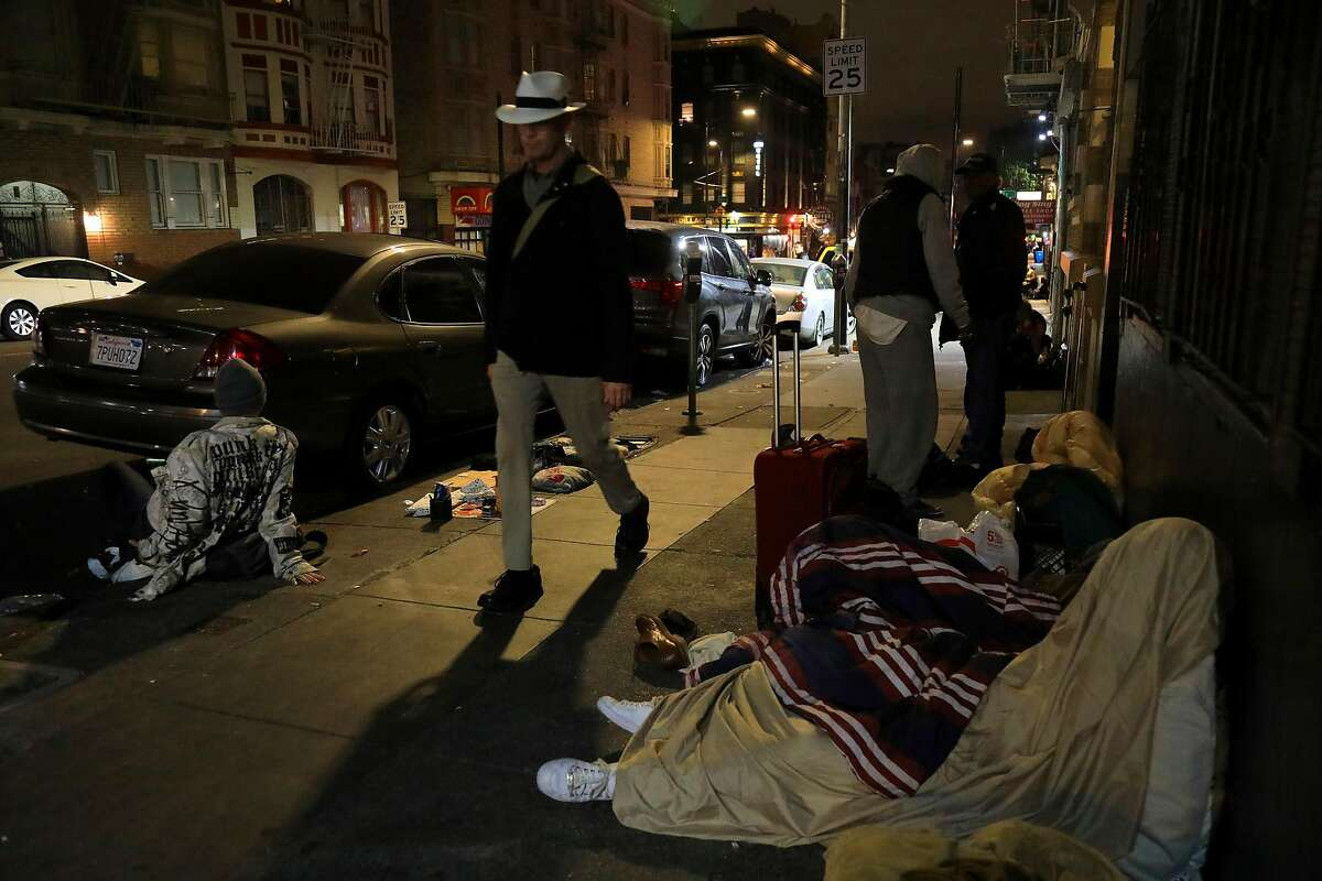 FILE -- Homeless people on Hyde Street in San Francisco, Sept. 14, 2018. San Francisco has bussed thousands of homeless people across country to destinations where family or friends might help get them back on their feet. The city found that less than 5 percent ended up back in the city receiving assistance. (Jim Wilson/The New York Times)