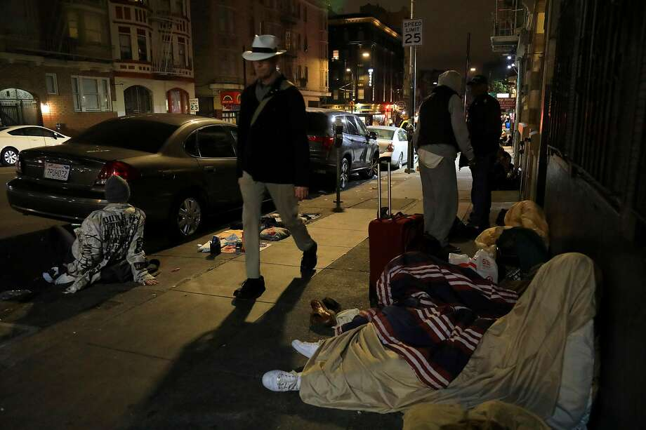FILE -- Homeless people on Hyde Street in San Francisco, Sept. 14, 2018. San Francisco has bussed thousands of homeless people across country to destinations where family or friends might help get them back on their feet. The city found that less than 5 percent ended up back in the city receiving assistance.  (Jim Wilson/The New York Times) Photo: Jim Wilson, NYT