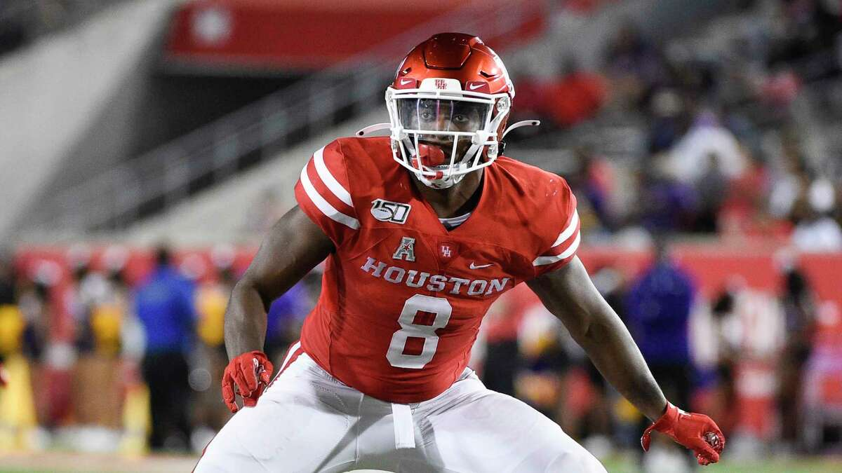 Houston linebacker Jordan Carmouche plays during the second half of an NCAA college football game against Prairie View , Saturday. Sept. 7, 2019, in Houston. (AP Photo/Eric Christian Smith)