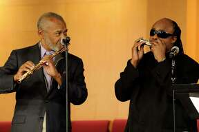 """Hubert Laws, left, Flutist and former member of """"The Jazz Crusaders"""" is joined by Stevie Wonder at the funeral of Freddie Hubbard in Los Angeles, California on Tuesday Jan. 6, 2009."""