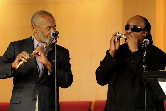 "Hubert Laws, left, Flutist and former member of ""The Jazz Crusaders"" is joined by Stevie Wonder at the funeral of Freddie Hubbard in Los Angeles, California on Tuesday Jan. 6, 2009."