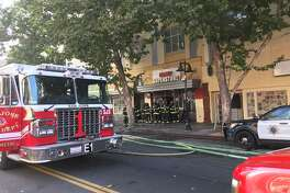 One person has died and four firefighters were injured fighting a three-alarm fire in downtown San Jose Sunday night, a fire investigators believe may have been intentionally set.