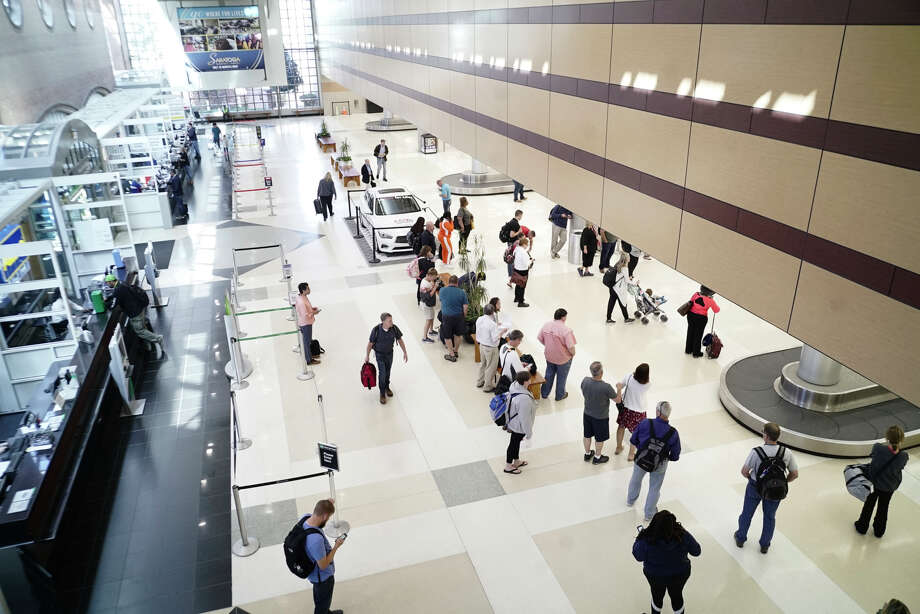 Travelers wait to collect their luggage in the baggage claim area of the Albany international airport on Monday, September 16, 2019, in Colonie, N.Y.   (Paul Buckowski/Times Union) Photo: Paul Buckowski, Albany Times Union / (Paul Buckowski/Times Union)