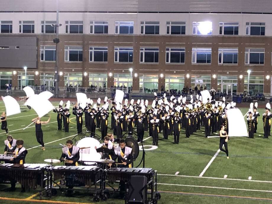 The Trumbull High School Golden Eagle Marching Band  earned a score of 84.375 and won best music, best visuals and best overall effect in Class V Open at Brien McMahon High School in Norwalk Saturday. Photo: Contributed Photo