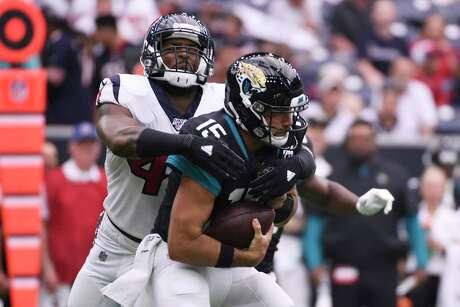 Jacksonville Jaguars quarterback Gardner Minshew (15) is hit by Houston Texans inside linebacker Zach Cunningham (41) during the first half of an NFL football game Sunday, Sept. 15, 2019, in Houston. (AP Photo/Eric Christian Smith)