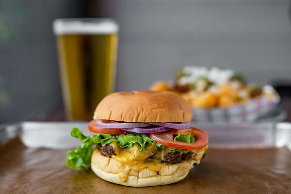 Classic burger, tots and beer at FM Kitchen & Bar, 1112 Shepherd.