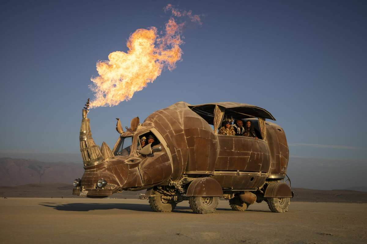 The Rhino Redemption is a massive art installation on wheels. Petaluma artist Kevin Clark built it over the chassis a 1974 Chevy pickup. The art car made its first appearance at Burning Man in 2014. It has since been outfitted with startling new flame effects that cast big shadows even in broad daylight.
