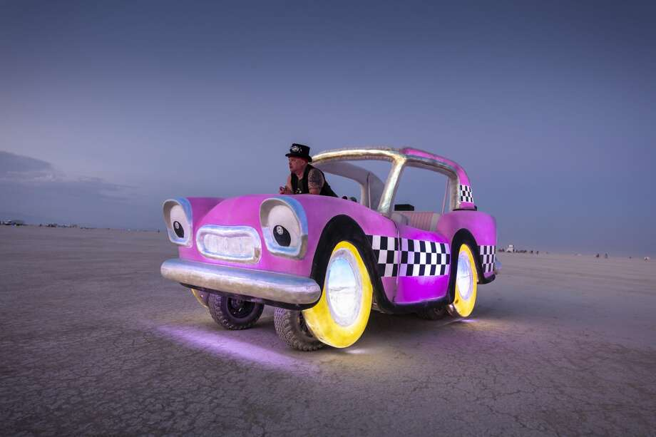 Hani owns and operates the Deep Playa Taxi, one of the more whimsical art cars at Burning Man. He says he commissioned Los Angeles artist and engineer David Shields, the master art car builder behind several of the most eye-popping vehicles at the event, to create the car based on his original design ideas. Photo: Scott London