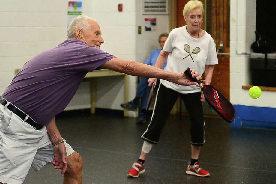 Richard Nichols and Mary Holland play Pickleball Tuesday, June 25, 2019, at the Norwalk Senior Center. Photo: Erik Trautmann / Hearst Connecticut Media / Norwalk Hour