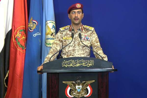 An image grab taken from a video made available by al-Huthi Media Office shows Huthi military spokesman Brigadier-General Yahya Saree speaking at a press conference on September 14, 2019, during which Yemen's Iran-aligned rebels claimed responsibility for the drone attacks on Saudi Aramco's processing plants in Abqaiq and Khurais. - Saudi Arabia said it was ready to respond to drone attacks claimed by Iran-aligned Yemeni rebels on two major oil facilities, which severely disrupted production as Washington blamed Tehran for the strike. (Photo by - / Al-Huthi Group Media Office / AFP)-/AFP/Getty Images
