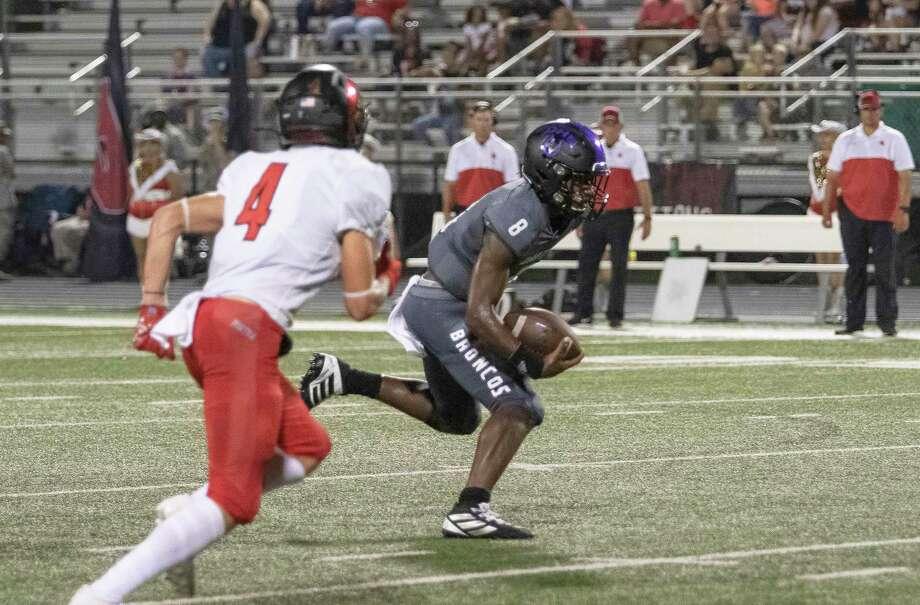 Dayton quarterback Christian Olige scrambles for yardage in the Broncos loss to Porter last Friday, 19-7. Photo: Amanda Jordan