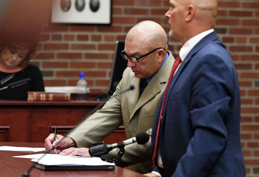 Dickie Winn, left, the 59-year-old Cohoes man charged with vehicular homicide and manslaughter charges in connection with a crash that killed two in Clifton Park this summer, pleads guilty before Saratoga County Court Judge James A. Murphy III on Monday, Sept.16, 2019, in Ballston Spa, N.Y. He is scheduled for sentencing in November. (Will Waldron/Times Union)