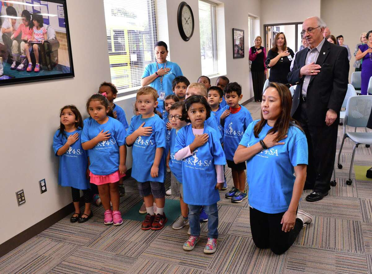 Pre-K for SA students from the Pre-K for SA North Center recite the Pledge of Allegiance as philanthropist Havey Najim (right) looks on prior to a press conference Monday to announce an early education initiative focusing on community support for children from birth to age 8.