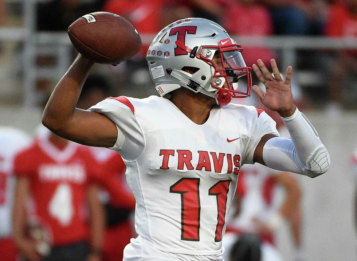 Travis quarterback Eric Rodriguez throws a pass during the first half of a high school football game against Hightower on Friday, Aug. 30, in Iowa Colony.