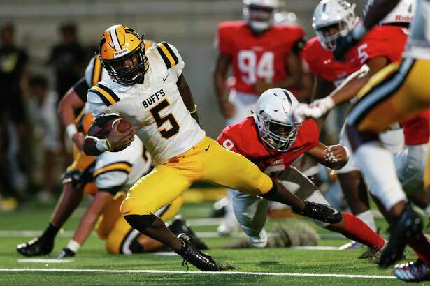 Fort Bend Marshall's Devon Achane (5) dives past Manvel's Noah Haygood (9) for the winning two point conversion in overtime last season in Rosharon.