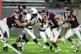 Evan Dunn (13) of Cinco Ranch carries the ball on a quarterback keeper in the third quarter of a high school football game between the Cinco Ranch Cougars and the Cy Ranch Mustangs on Saturday, August 31, 2019 at Legacy Stadium, Katy, TX.