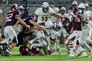 Willie Eldridge (5) of Cy Ranch is tackled in the third quarter of a high school football game between the Cinco Ranch Cougars and the Cy Ranch Mustangs on Saturday, August 31, 2019 at Legacy Stadium, Katy, TX.