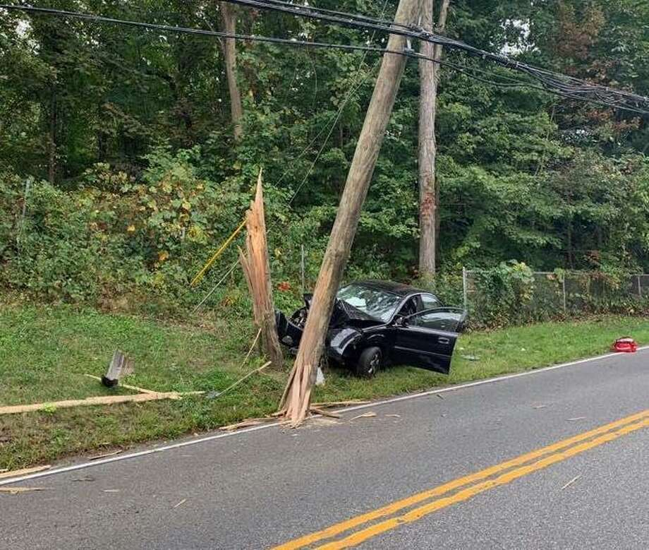A car crashed into a pole on Main Street South on Sept. 14, 2019. Photo: Facebook / Southbury Fire Department