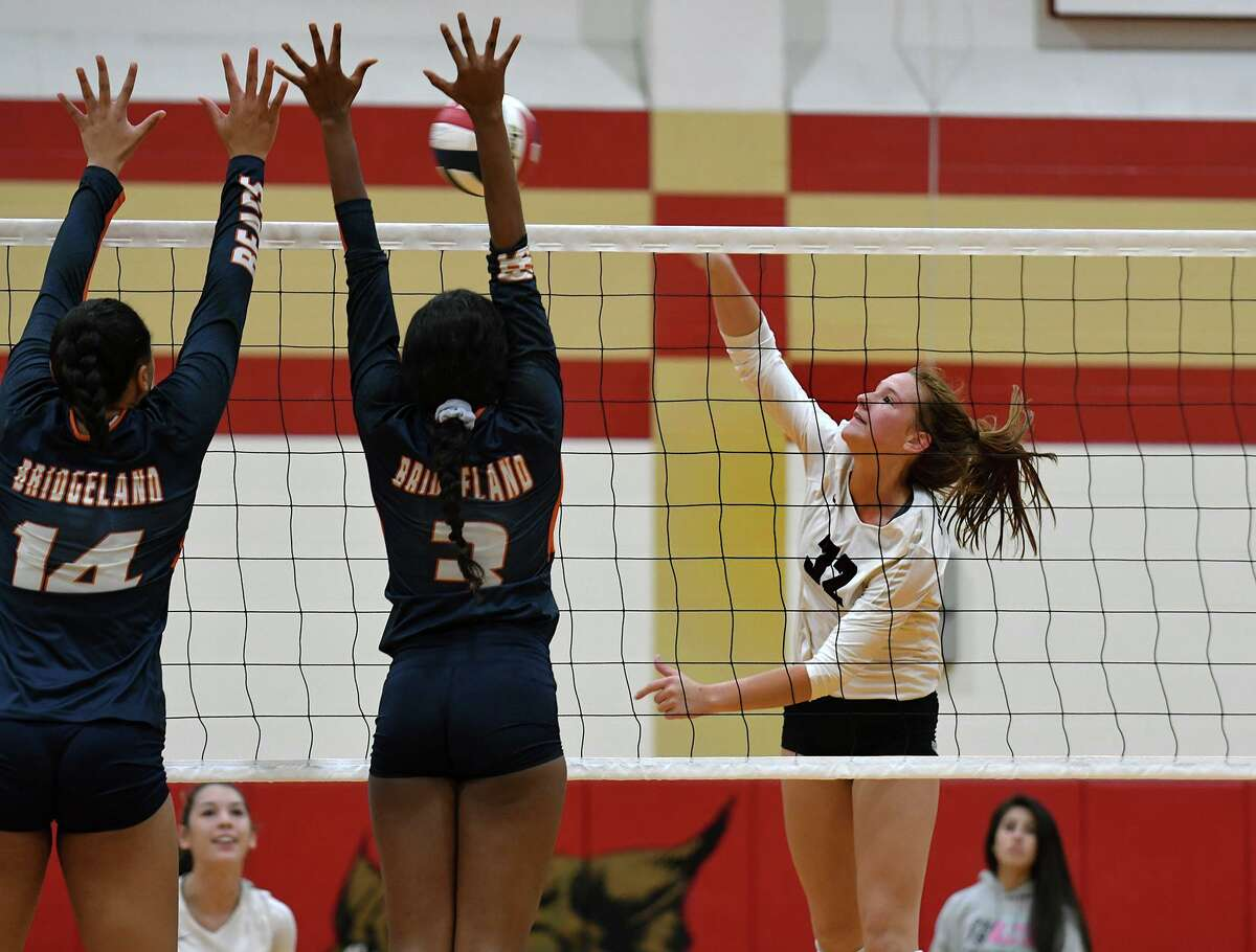 Cinco Ranch freshman right side Courtney O'Brien (20) makes a play at the net against Bridgeland's Karrington Kays (14) and Alyssa McMorris (3) during their Gold Bracket semi-final matchup at the 2019 Katy/Cy-Fair Volleyball Classic at Cy Woods High School on August 10, 2019.