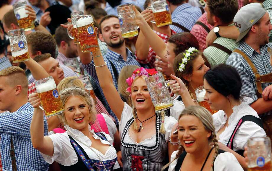Oktoberfest season is upon us, and eight area establishments are ready to celebrate the German festival with German beer food. Here's a breakdown of Oktoberfest happenings. Photo: Matthias Schrader /Associated Press / AP