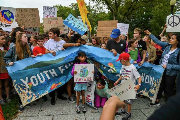 Young climate activists participate in a climate strike demonstration outside the White House on Sept. 13, 2019, in Washington, D.C.