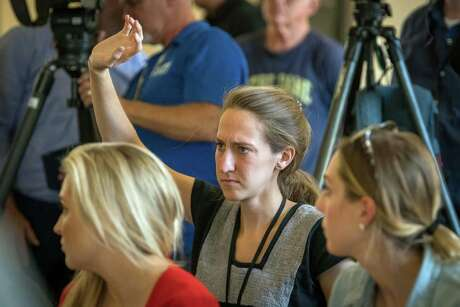 Houston Chronicle reporter Emily Foxhall at a news conference in Odessa, where a mass shooting left seven victims dead.
