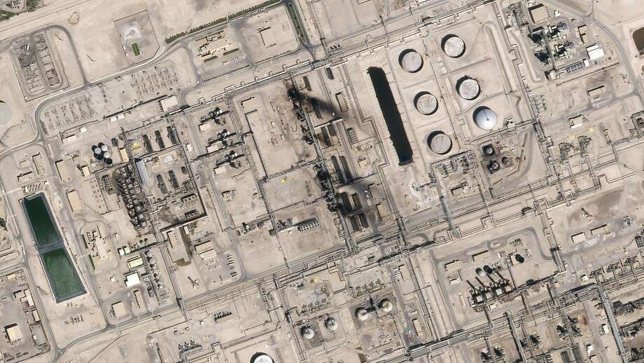 "This satellite overview handout image obtained September 16, 2019 courtesy of Planet Labs Inc.  shows damage to oil/gas infrastructure from weekend drone attacks at Abqaig on September 15, 2019 in Saudi Arabia. - Drone attacks on key Saudi oil facilities have halved crude output from OPEC's biggest exporter, catapulting oil prices by the largest amount since the first Gulf War. The crisis has focused minds on unrest in the crude-rich Middle East, with Tehran denying Washington's charge that it was responsible.Brent oil prices leapt 20 percent on Monday to chalk up the biggest intra-day daily gain since 1991. (Photo by HO / PLANET LABS INC. / AFP) / RESTRICTED TO EDITORIAL USE - MANDATORY CREDIT ""AFP PHOTO / Planet Labs Inc. / HO"" - NO MARKETING NO ADVERTISING CAMPAIGNS - DISTRIBUTED AS A SERVICE TO CLIENTS == NO ARCHIVEHO/AFP/Getty Images Photo: Ho, AFP/Getty Images"