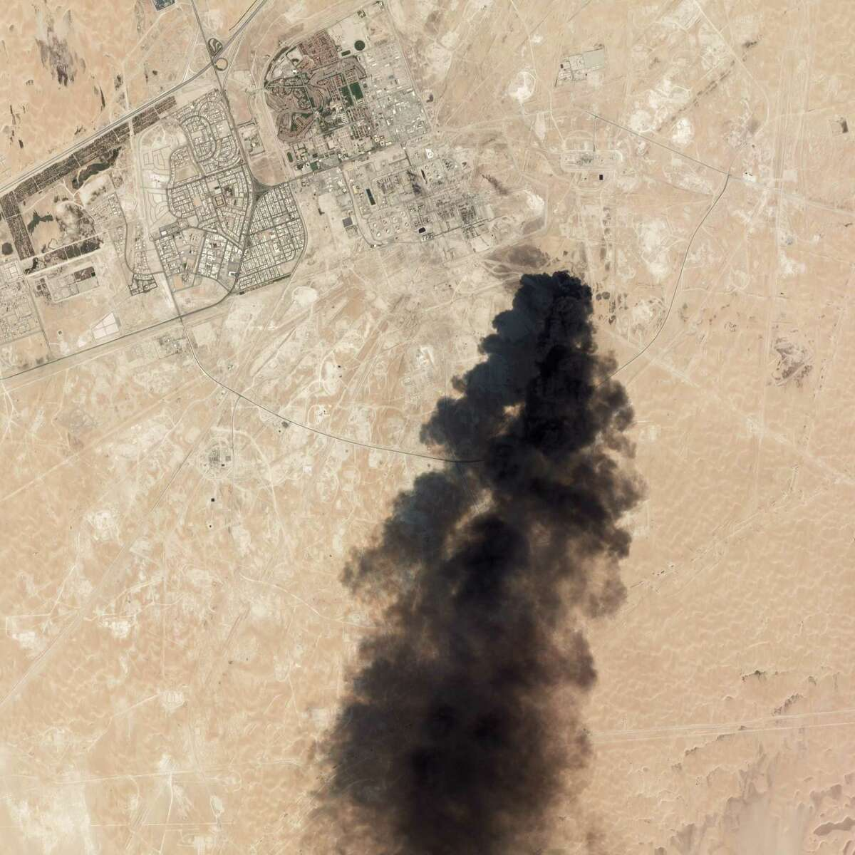 """This satellite overview handout image obtained September 16, 2019 courtesy of Planet Labs Inc. shows damage to oil/gas infrastructure from weekend drone attacks at Abqaig on September 14 2019 in Saudi Arabia. - Drone attacks on key Saudi oil facilities have halved crude output from OPEC's biggest exporter, catapulting oil prices by the largest amount since the first Gulf War. The crisis has focused minds on unrest in the crude-rich Middle East, with Tehran denying Washington's charge that it was responsible.Brent oil prices leapt 20 percent on Monday to chalk up the biggest intra-day daily gain since 1991. (Photo by HO / PLANET LABS INC. / AFP) / RESTRICTED TO EDITORIAL USE - MANDATORY CREDIT """"AFP PHOTO / Planet Labs Inc. / HO"""" - NO MARKETING NO ADVERTISING CAMPAIGNS - DISTRIBUTED AS A SERVICE TO CLIENTS == NO ARCHIVEHO/AFP/Getty Images"""