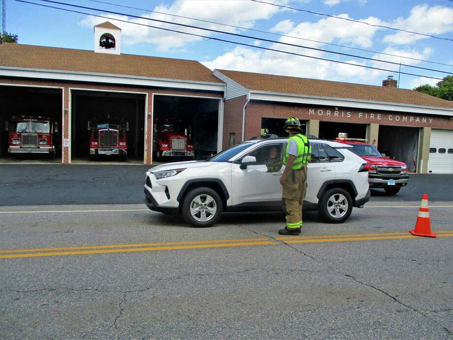 Firefighter Tom Weik chats with a donor who stopped in front of the Morris firehouse. Photo: Jo Ann Jaacks / Contributed Photo