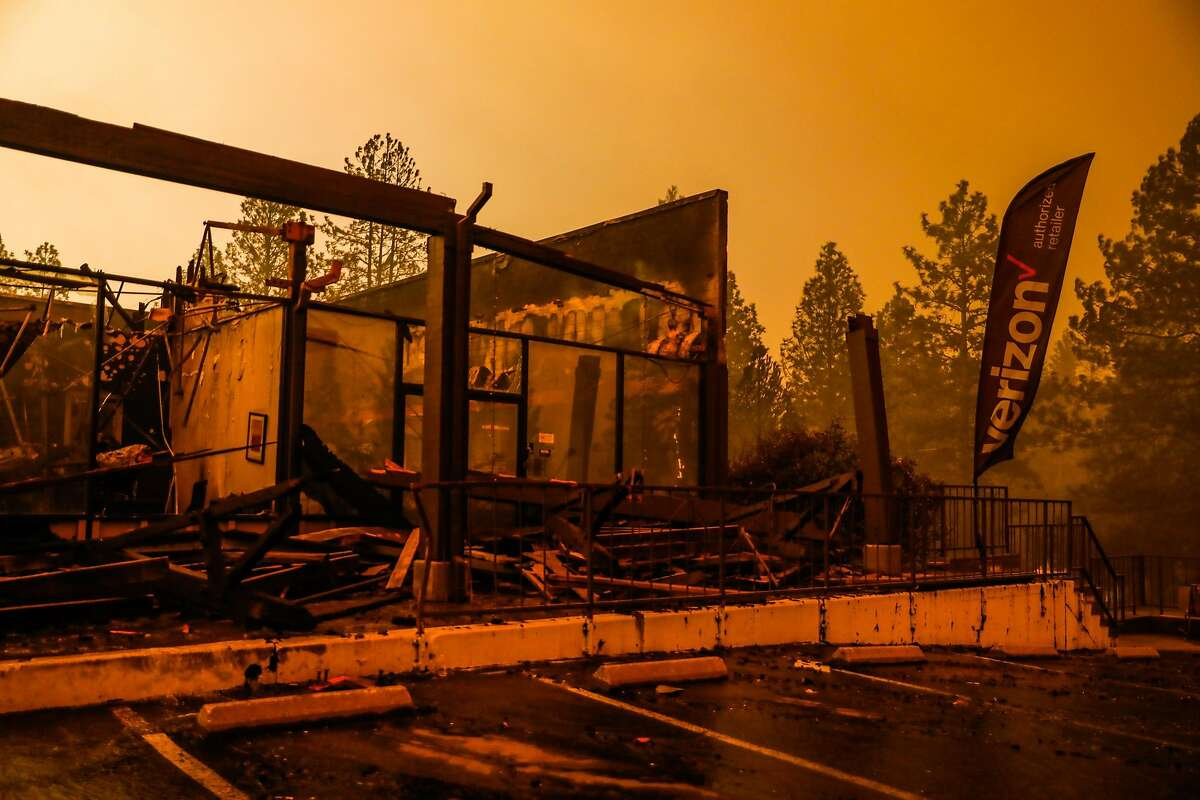 The Verizon store is seen destroyed off of Clark Road after the Camp Fire tore through the town of Paradise, California, on Friday, Nov. 9, 2018.