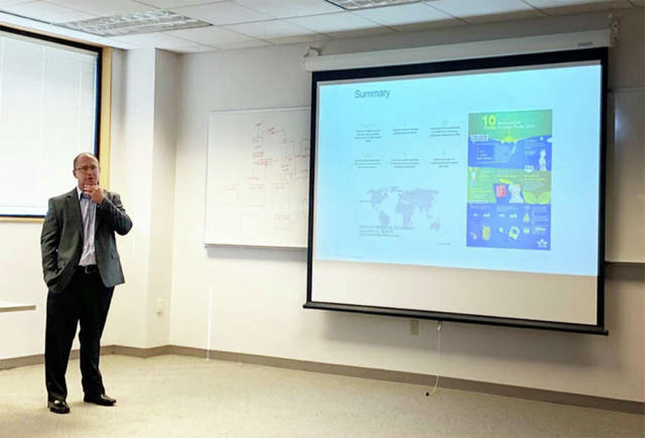 "Joe Ellsworth, regional director of environmental strategy and integration for The Boeing Company, presents ""Boeing and Sustainable Aviation Fuels"" to the NCERC at SIUE. Photo: For The Intelligencer"