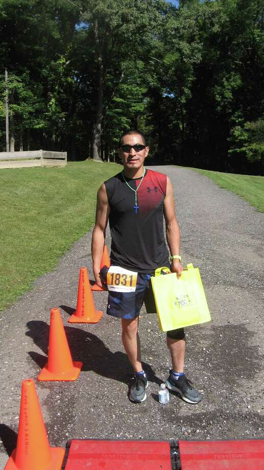 The 10th annual Miles 4 Moe road race and harvest festival was held Sunday, Sept. 15, 2019 at Camp MOE in Torrington. Above, first place finisher Marco Sarmiento of Goshen. Photo: John Torsiello / For Hearst Connecticut Media /