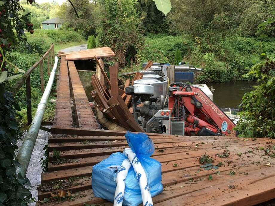 A truck hauling septic vaults on Sept. 16 was crossing a bridge over Woods Creek in Monroe, Washington when it collapsed, according to Snohomish County fire officials. There were no reported injuries. Photo: Snohomish County Fire District 7