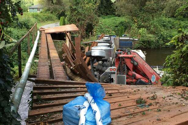 A truck hauling septic vaults on Sept. 16 was crossing a bridge over Woods Creek in Monroe, Washington when it collapsed, according to Snohomish County fire officials. There were no reported injuries.