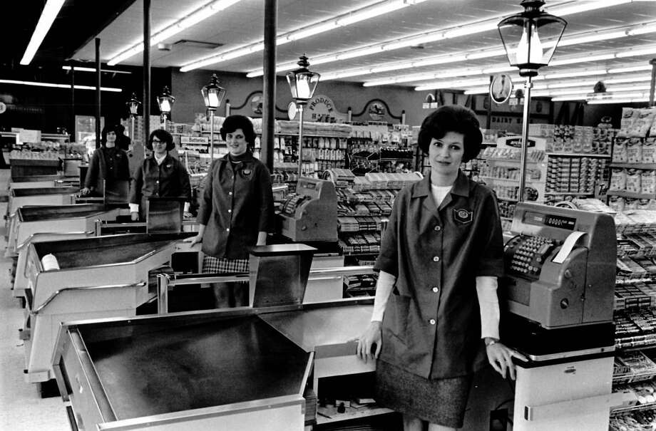 Standing at the check out counters of the new Wentworth IGA at Isabella and Vance roads are, from left, Mrs. Walter McNight, Mrs. Gary Gable, Miss Caroll Storms and Mrs. Ray Koenders. The market includes a delicatessen department and fresh baked good section. December 1970 Photo: Daily News File Photos