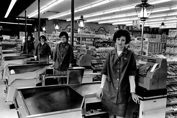 Standing at the check out counters of the new Wentworth IGA at Isabella and Vance roads are, from left, Mrs. Walter McNight, Mrs. Gary Gable, Miss Caroll Storms and Mrs. Ray Koenders. The market includes a delicatessen department and fresh baked good section. December 1970