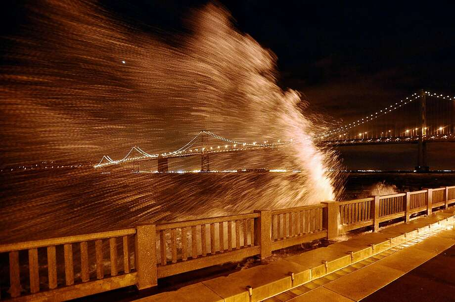 Waves break over the Embarcadero seawall near the foot of Howard Street. Photo: Noah Berger / Special To The Chronicle 2008