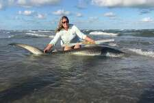 A Texas woman reached her personal best after she caught a 9-foot tiger shark in Corpus Christi earlier this month.